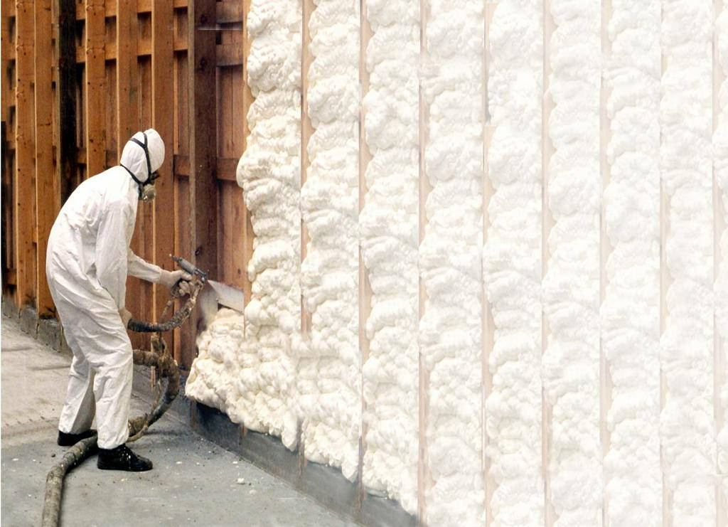 Person using polyurethane spray foam insulation to insulate building structure.