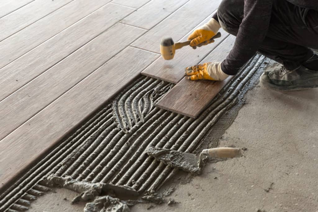 Worker laying mortar and tile